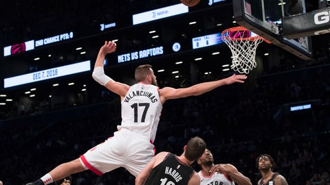 <p>               Brooklyn Nets forward Joe Harris (12) fouls Toronto Raptors center Jonas Valanciunas (17) during the first half of an NBA basketball game, Friday, Dec. 7, 2018, in New York. (AP Photo/Mary Altaffer)             </p>