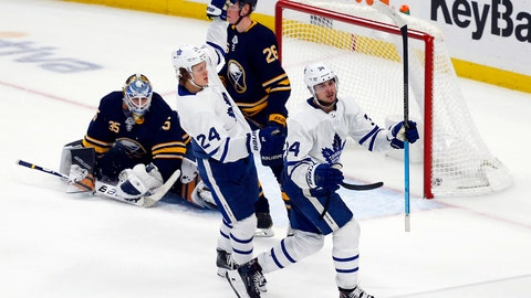 <p>               Toronto Maple Leafs forward Auston Matthews (34) puts the puck past Buffalo Sabres goalie Linus Ullmark (35) during the overtime period of an NHL hockey game, Tuesday, Dec. 4, 2018, in Buffalo N.Y. (AP Photo/Jeffrey T. Barnes)             </p>