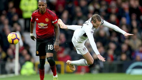 <p>               Manchester United's Ashley Young, left and Fulham's Andre Schurrle battle for the ball during the English Premier League soccer match between Manchester United and Fulham, at Old Trafford, Manchester, England, Saturday, Dec. 8, 2018. (Barrington Coombs/PA via AP)             </p>