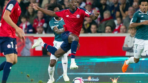 <p>               FILE - In this Saturday, Sept. 22, 2018 file photo, Lille's Nicolas Pepe, center, controls the ball during the French League One soccer match between Lille and Nantes at the Lille Metropole stadium, in Villeneuve d'Ascq, northern France. The race to finish as the French league's top scorer was expected to be a three-way contest between Paris Saint-Germain forwards Neymar, Kylian Mbappe and Edinson Cavani. But unheralded forwards Nicolas Pepe and Emiliano Sala are keeping pace with PSG's stars. (AP Photo/Michel Spingler, File)             </p>