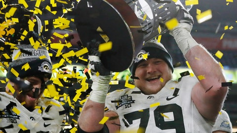 <p>               FILE - In this Dec. 27, 2017, file photo, Iowa right tackle Sean Welsh (79) holds up the trophy as confetti falls after Iowa defeated Boston College, 27-20, in  the Pinstripe Bowl NCAA college football game in New York. The fun starts for those who did get into the postseason _ and those who get to watch it _ Saturday with five FBS bowl games and stretches through New Year's Day. (AP Photo/Kathy Willens, File)             </p>