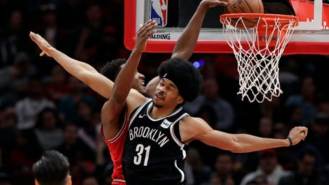 <p>               Chicago Bulls center Wendell Carter Jr., left, dunks against Brooklyn Nets center Jarrett Allen during the second half of an NBA basketball game, Wednesday, Dec. 19, 2018, in Chicago. The Nets won 96-93. (AP Photo/Nam Y. Huh)             </p>