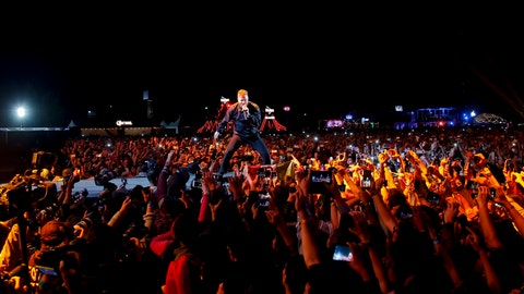 <p>               FILE - In this Nov. 18, 2018, file photo, Dan Reynolds, center, of the band Imagine Dragons performs on the second day of the Corona Capital music festival in Mexico City. Grammy Award winners Imagine Dragons will perform at halftime of the College Football Playoff championship game on Jan. 7, 2019. ESPN and Interscope Records announced the performance Monday, Dec. 10, 2018. (AP Photo/Eduardo Verdugo, File)             </p>