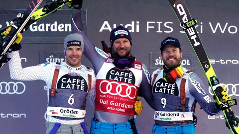 <p>               From left, second placed Italy's Christof Innerhofer, first placed Norway's Aksel Lund Svindal and third placed Norway's Kjetil Jansrud celebrate on the podium at the end of an alpine ski, men's World Cup super-G, in Val Gardena, Italy, Friday, Dec. 14, 2018. (AP Photo/Giovanni Auletta)             </p>