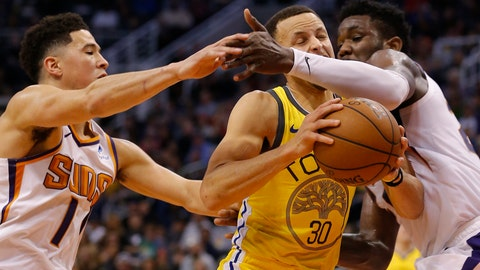<p>               Golden State Warriors guard Stephen Curry (30) drives between Phoenix Suns' Devin Booker (1) and Deandre Ayton during the first half of an NBA basketball game Monday, Dec. 31, 2018, in Phoenix. (AP Photo/Rick Scuteri)             </p>