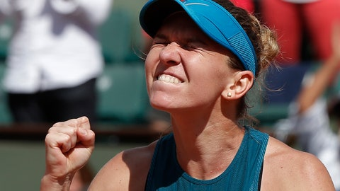 <p>               Romania's Simona Halep clenches her fist after defeating Spain's Garbine Muguruza during their semifinal match at the French Open tennis tournament in Paris on June 7, 2018. Halep won 6-1, 6-4. (AP Photo/Michel Euler)             </p>