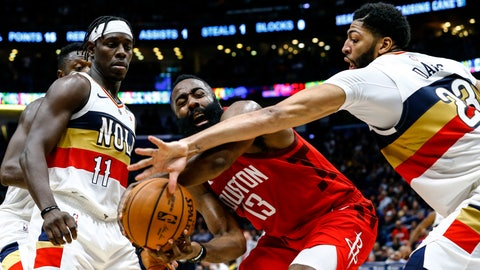 <p>               New Orleans Pelicans forward Anthony Davis (23) and guard Jrue Holiday (11) try to steal the ball from Houston Rockets guard James Harden (13) during the second half of an NBA basketball game Saturday, Dec. 29, 2018, in New Orleans. Houston won 108-104. (AP Photo/Butch Dill)             </p>