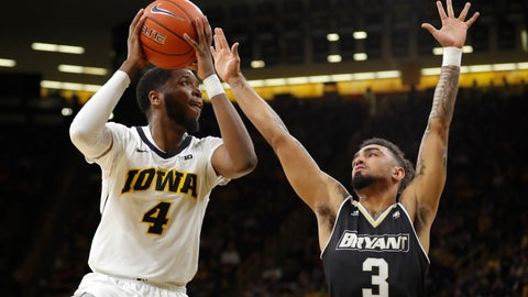 <p>               Iowa guard Isaiah Moss (4) drives to the basket as Bryant guard Byron Hawkins (3) defends during the first half of an NCAA college basketball game Saturday, Dec. 29, 2018, in Iowa City, Iowa.(AP Photo/Charlie Neibergall)             </p>