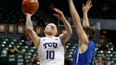<p>               TCU guard Jaylen Fisher (10) tries to shoot over Indiana State guard Clayton Hughes (13) during the first half of an NCAA college basketball game at the Diamond Head Classic Tuesday, Dec. 25, 2018, in Honolulu. (AP Photo/Marco Garcia)             </p>