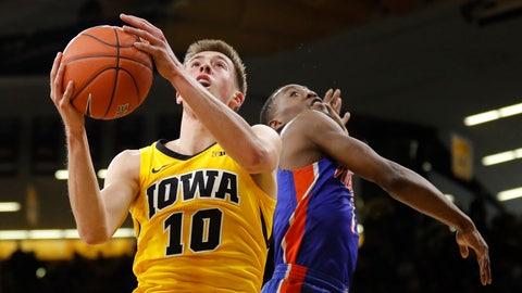 <p>               Iowa guard Joe Wieskamp (10) drives to the basket past Savannah State guard Zaquavian Smith, right, during the first half of an NCAA college basketball game, Saturday, Dec. 22, 2018, in Iowa City, Iowa.(AP Photo/Charlie Neibergall)             </p>