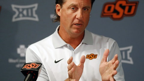 """<p>               FILE - In this Aug. 24, 2018, file photo, Oklahoma State head coach Mike Gundy talks with the media during an NCAA college football news conference in Stillwater, Okla. College football recruiting fans used to treat the first Wednesday of February like a virtual national holiday. Now that date's been pushed into the background, likely for good.""""I just think everybody sees (December) as the new signing date, in my opinion,"""" Oklahoma State coach Mike Gundy said. (AP Photo/Sue Ogrocki, File)             </p>"""