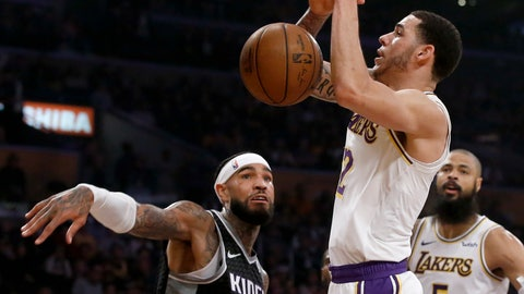 <p>               Sacramento Kings center Willie Cauley-Stein, left, knocks the ball away from Los Angeles Lakers guard Lonzo Ball, center, with center Tyson Chandler, right, watching during the first half of an NBA basketball game in Los Angeles, Sunday, Dec. 30, 2018. (AP Photo/Alex Gallardo)             </p>