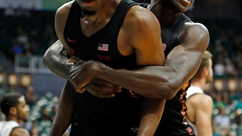 <p>               UNLV forward Joel Ntambwe (24) celebrates with forward Jonathan Tchamwa Tchatchoua (30) after he made a basket and drew a foul against Hawaii during the second half of an NCAA college basketball game at the Diamond Head Classic, Saturday, Dec. 22, 2018, in Honolulu. (AP Photo/Marco Garcia)             </p>
