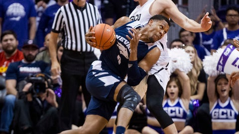 <p>               Nevada's Tre'Shawn Thurman tries to get around Grand Canyon's Gerald Martin during the first half of an NCAA college basketball game Sunday, Dec. 9, 2018, in Phoenix. (AP Photo/Darryl Webb)             </p>