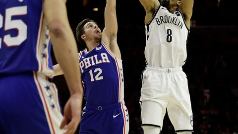 <p>               Brooklyn Nets' Spencer Dinwiddie (8) goes up for a shot against Philadelphia 76ers' T.J. McConnell (12) during the second half of an NBA basketball game, Wednesday, Dec. 12, 2018, in Philadelphia. Brooklyn won 127-124. (AP Photo/Matt Slocum)             </p>