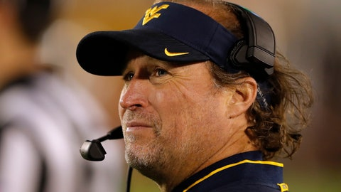 <p>               FILE - In this Oct. 13, 2018 file photo West Virginia head coach Dana Holgorsen watches from the sideline during the second half of an NCAA college football game against Iowa State in Ames, Iowa. Holgorsen can earn a $50,000 bonus if West Virginia beats Syracuse next week in the Camping World Bowl, a game the Mountaineers will play without star quarterback Will Grier and left tackle Yodny Cajuste. (AP Photo/Charlie Neibergall, file)             </p>