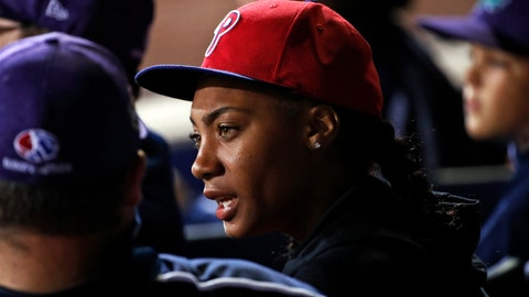<p>               FILE - In this Aug. 19, 2018, file photo, Philadelphia Phillies fan Mo'ne Davis, center, who threw a shutout against Tennessee while competing in the 2014 Little League World Series tournament, talks with members of this year's team from Panama, at the Little League Classic baseball game between the Philadelphia Phillies and the New York Mets, in Williamsport, Pa. Davis, the first girl to pitch a victory in the Little League World Series, will attend Hampton University and play softball. (AP Photo/Gene J. Puskar, File)             </p>