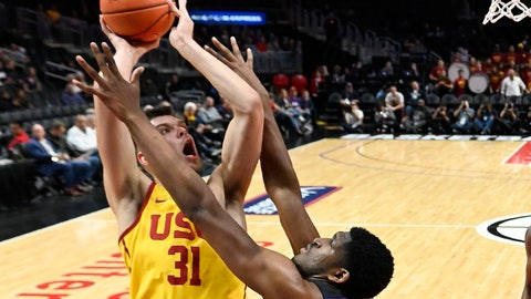 <p>               Southern California forward Nick Rakocevic, left, shoots as TCU center Kevin Samuel defends during the first half of an NCAA college basketball game at the Air Force Reserve Classic on Friday, Dec. 7, 2018, in Los Angeles. (AP Photo/Mark J. Terrill)             </p>