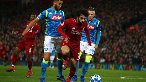 <p>               Liverpool forward Mohamed Salah, second from right, plays the ball during the Champions League Group C soccer match between Liverpool and Napoli at Anfield stadium in Liverpool, England, Tuesday, Dec. 11, 2018.(AP Photo/Dave Thompson)             </p>