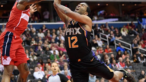 <p>               Phoenix Suns forward T.J. Warren (12) goes to the basket against Washington Wizards guard Bradley Beal, left, during the first half of an NBA basketball game, Saturday, Dec. 22, 2018, in Washington. (AP Photo/Nick Wass)             </p>