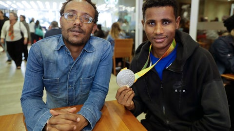 <p>               In this Nov. 20, 2018 photo, Ethiopian paralympic athletes Megersa Bati, left, and Tamiru Kefeyalew Demisse, holding the silver medal he won in the 1,500 meters race at the 2016 Paralympics, pose for a photo in Sao Paulo, Brazil. (AP Photo/Andre Penner)             </p>