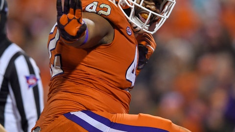 <p>               File-This Nov. 24, 2018, file photo shows Clemson's Christian Wilkins doing the Heisman pose after scoring a touchdown during the first half of an NCAA college football game against South Carolina, in Clemson, S.C. Wilkins is here to put a smile on your face, whether you like it or not. For four seasons, Wilkins has been bringing the jokes, zingers and sneaky pinches on the bottom at Clemson. The 300-pound All-America defensive tackle famously celebrated the Tigers' 2016 national championship with a split and flashed a Heisman pose after a touchdown run this season. (AP Photo/Richard Shiro, File)             </p>