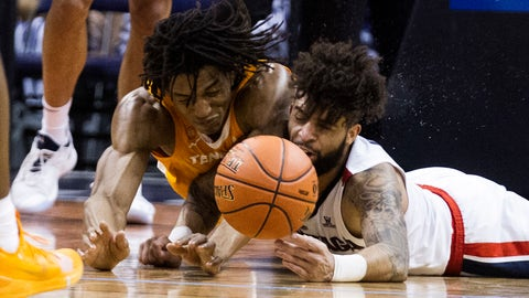 <p>               Tennessee's Yves Pons (35) and Gonzaga's Josh Perkins (13) collide while going for the ball during the first half of an NCAA college basketball game Sunday, Dec. 9, 2018, in Phoenix. (AP Photo/Darryl Webb)             </p>