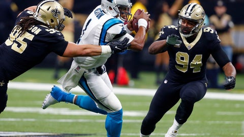 <p>               FILE - In this Jan. 7, 2018, file photo, Carolina Panthers quarterback Cam Newton (1) carries between New Orleans Saints defensive tackle Tyeler Davison (95) and defensive end Cameron Jordan (94) in the first half of an NFL football game in New Orleans. Jordan and the Saints are looking to beat the Panthers twice in the final three weeks of the season and wrap up home-field advantage in the NFC playoffs.  (AP Photo/Butch Dill, File)             </p>
