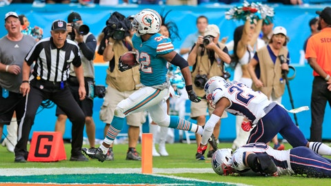<p>               Miami Dolphins running back Kenyan Drake (32) scores to defeat the New England Patriots at Hard Rock Stadium in Miami Gardens on Sunday, Dec. 9, 2018. (Al Diaz/Miami Herald via AP)             </p>