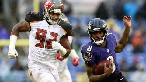 <p>               Baltimore Ravens quarterback Lamar Jackson, right, rushes past Tampa Bay Buccaneers defensive tackle William Gholston in the second half of an NFL football game, Sunday, Dec. 16, 2018, in Baltimore. (AP Photo/Gail Burton)             </p>