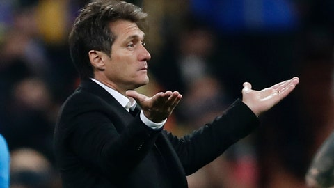 <p>               Guillermo Barros Schelotto, coach of Argentina's Boca Juniors, gestures during the Copa Libertadores final soccer match against Argentina's River Plate at the Santiago Bernabeu stadium in Madrid, Spain, Sunday, Dec. 9, 2018. (AP Photo/Manu Fernandez)             </p>
