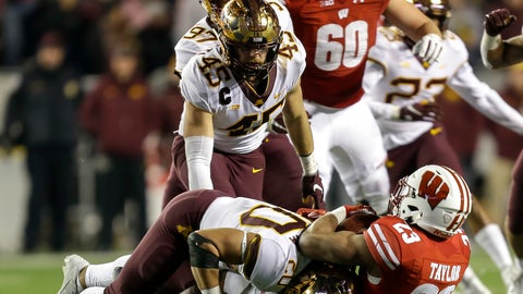 <p>               Minnesota linebacker Julian Huff (20) tackles Wisconsin running back Jonathan Taylor (23) behind the line of scrimmage during the second half of an NCAA college football game Saturday, Nov. 24, 2018, in Madison, Wis. Minnesota won 37-15. (AP Photo/Andy Manis)             </p>