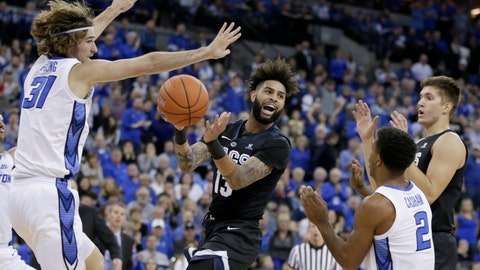 <p>               Gonzaga's Josh Perkins (13) passes the ball between Creighton's Samson Froling (31) and Connor Cashaw (2) during the first half of an NCAA college basketball game in Omaha, Neb., Saturday, Dec. 1, 2018. (AP Photo/Nati Harnik)             </p>