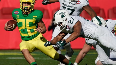 <p>               Oregon Ducks running back Travis Dye (26) rushes for a first down past Michigan State Spartans safety Khari Willis (27) during the first half of the Redbox Bowl NCAA college football game Monday, Dec. 31, 2018, in Santa Clara, Calif. (AP Photo/Tony Avelar)             </p>
