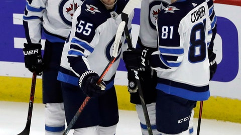 <p>               Winnipeg Jets center Mark Scheifele (55) is congratulated by teammates after scoring his goal against the Chicago Blackhawks during the first period of an NHL hockey game Friday, Dec. 14, 2018, in Chicago. (AP Photo/Nam Y. Huh)             </p>