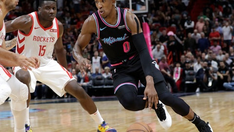 <p>               Miami Heat guard Josh Richardson (0) drives as Houston Rockets center Clint Capela (15) defends during the second half of an NBA basketball game, Thursday, Dec. 20, 2018, in Miami. The Heat won 101-99. (AP Photo/Lynne Sladky)             </p>