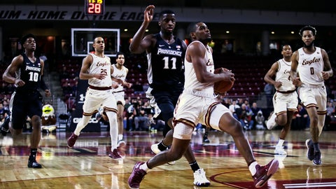 <p>               Boston College guard Wynston Tabbs, foreground, outruns Providence guard Alpha Diallo (11) on a drive to the basket during the first half of an NCAA college basketball game in Boston, Tuesday, Dec. 4, 2018. (AP Photo/Charles Krupa)             </p>