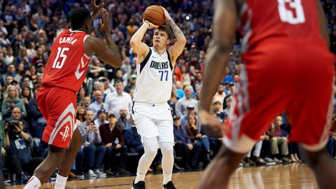 <p>               Dallas Mavericks forward Luka Doncic (77) shoots a 3-pointer over Houston Rockets center Clint Capela (15) during the second half of an NBA basketball game, Saturday, Dec. 8, 2018, in Dallas. (AP Photo/Cooper Neill)             </p>