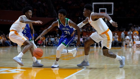 <p>               Texas A&M-Corpus Christi Tre Gray (21) tries to move past Tennessee Jordan Bowden, left, and Admiral Schofield, right, in the second half of an NCAA college basketball game Sunday, Dec. 2, 2018, in Knoxville, Tenn. (AP Photo/Shawn Millsaps)             </p>