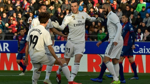 <p>               Real Madrid's Gareth Bale, center, celebrates with his fellow team after scoring against SD Huesca during the Spanish La Liga soccer match between Real Madrid and SD Huesca at El Alcoraz stadium, in Huesca, northern Spain, Sunday, Dec. 9, 2018. (AP Photo/Alvaro Barrientos)             </p>