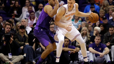 <p>               FILE - In this Jan. 26, 2018, file photo, New York Knicks forward Kristaps Porzingis (6) controls the ball in the first half of an NBA basketball game against the Phoenix Suns in Phoenix. Porzingis' left knee is healing well from a torn ACL and he will be re-evaluated in mid-February 2019. (AP Photo/Rick Scuteri, File)             </p>