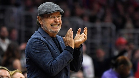 <p>               FILE - In this March 9, 2018, file photo, actor Billy Crystal applauds during the second half of an NBA basketball game between the Los Angeles Clippers and the Cleveland Cavaliers in Los Angeles.  Los Angeles Clippers announcer Ralph Lawler was approached two months ago with a special request. A longtime season-ticket holder asked team president Gillian Zucker if he could call a game on television with Lawler and honor his 40 seasons with the club. Lawler apprehensively said yes, until he found out it wasn't just any season-ticket holder. It happens to be Crystal, who has been the team's most well-known fan through the good times and bad, will be the analyst for the Jan. 31 game against the Lakers. (AP Photo/Mark J. Terrill, File)             </p>