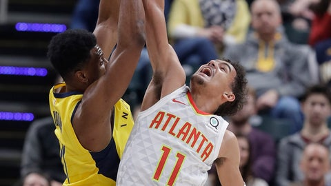 <p>               Indiana Pacers' Thaddeus Young, left, and Atlanta Hawks' Trae Young (11) battle for a rebound during the first half of an NBA basketball game, Monday, Dec. 31, 2018, in Indianapolis. (AP Photo/Darron Cummings)             </p>