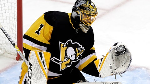 <p>               Pittsburgh Penguins goaltender Casey DeSmith gloves a shot during the first period of an NHL hockey game against the Colorado Avalanche in Pittsburgh, Tuesday, Dec. 4, 2018. (AP Photo/Gene J. Puskar)             </p>