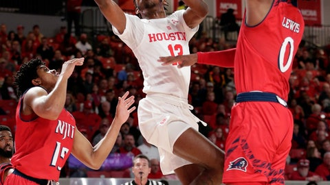 <p>               Houston guard Dejon Jarreau (13) shoots between New Jersey Institute of Technology guard Diandre Wilson (15) and forward Abdul Lewis (0) during the first half of an NCAA college basketball game Saturday, Dec. 29, 2018, in Houston. (AP Photo/Michael Wyke)             </p>