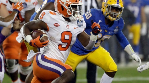 <p>               Clemson's Travis Etienne (9) runs past Pittsburgh's Dennis Briggs (20) in the first half of the Atlantic Coast Conference championship NCAA college football game in Charlotte, N.C., Saturday, Dec. 1, 2018. (AP Photo/Chuck Burton)             </p>