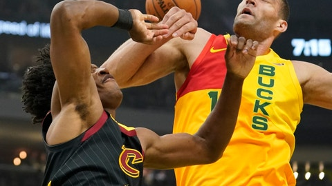 <p>               Cleveland Cavaliers' Collin Sexton and Milwaukee Bucks' Brook Lopez battle for a rebound during the first half of an NBA basketball game Monday, Dec. 10, 2018, in Milwaukee. (AP Photo/Morry Gash)             </p>