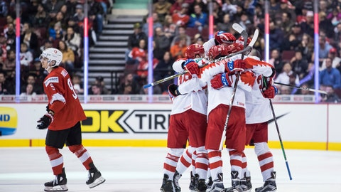 <p>               Switzerland's Nicolas Muller, from left, skates to the bench from the penalty box as Russia's Nikita Shashkov, Pavel Shen, Stepan Starkov, Alexander Romanov and Alexander Alexeyev celebrate Alexeyev's goal during the third period of a world junior hockey championships game in Vancouver, British Columbia, Sunday, Dec. 30, 2018. (Darryl Dyck/The Canadian Press via AP)             </p>