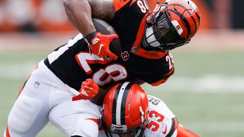 <p>               FILE - In this Nov. 25, 2018, file photo, Cincinnati Bengals running back Joe Mixon (28) is tackled by Cleveland Browns middle linebacker Joe Schobert (53) in the first half of an NFL football game in Cincinnati. The Bengals try to maintain their miniscule hopes of a playoff spot when they host the Raiders. (AP Photo/Gary Landers, File)             </p>
