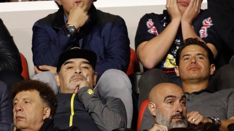 <p>               Dorados head coach Diego Maradona, left center, watches the final leg of Mexico's second division soccer league against Atletico San Luis, in San Luis Potosi, Mexico, Sunday, Dec. 2, 2018. Atletico San Luis beat Dorados 4-2 in the match, giving the aggregate series a 4-3 and is the champion of the second division. (AP Photo/Eduardo Verdugo)             </p>